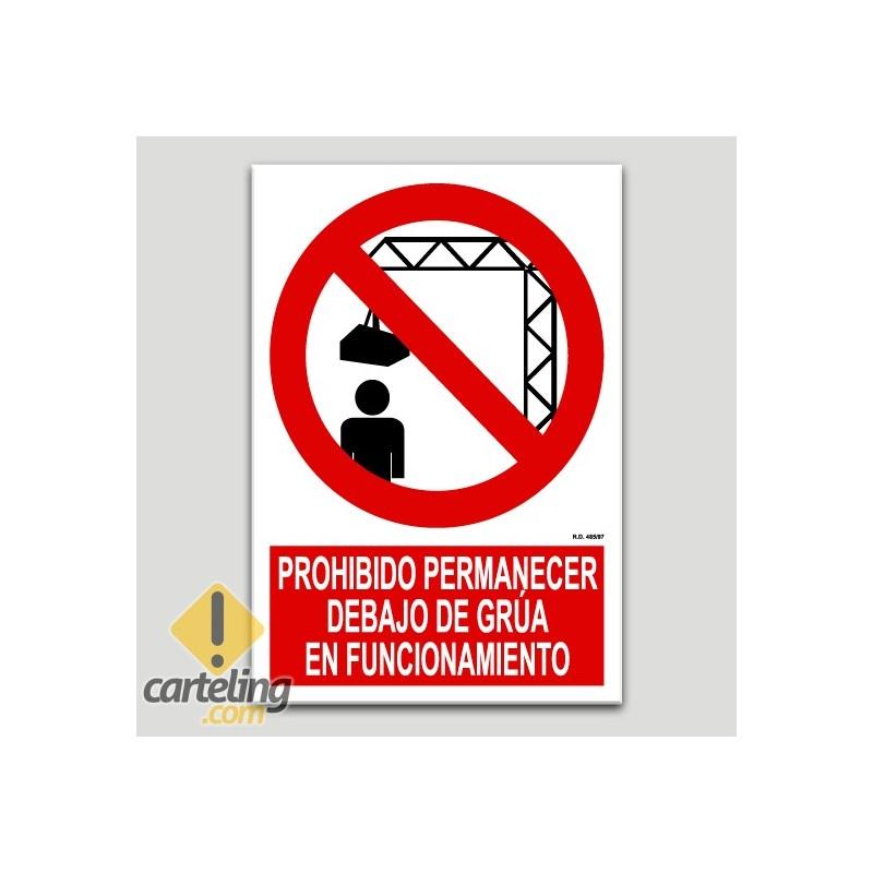 Prohibido permanecer debajo de grúa en funcionamiento